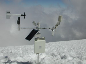 The automatic weather station on the southern ice field of Mount Kilimanjaro, the highest weather station in Africa, with instruments for measuring temperature, humidity, wind speed and direction, and radiation in different parts of the spectrum. (Image: Nicolas Cullen)